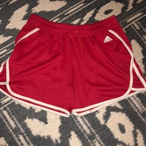 Red adidas running shorts